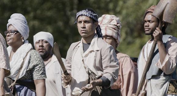 CJ Hunt participa en un reinactment de rebelión de esclavos.